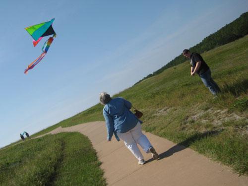 Mom and Jim flying a kite at Kittyhawk